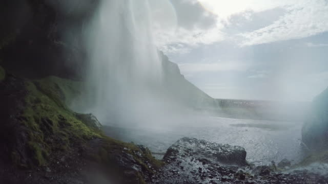 icelandic landscape. skogar waterfall. sunlight creates lens flares - power in nature stock videos & royalty-free footage