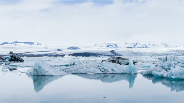 iceland's glacial lake jokulsarlon with icebergs floating in water - ice floe stock videos & royalty-free footage