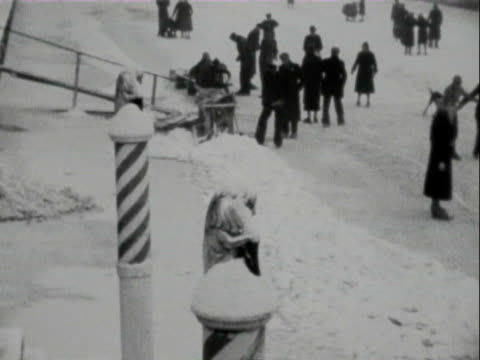 1947 b/w ice-skating children and adults / netherlands - eislaufen stock-videos und b-roll-filmmaterial