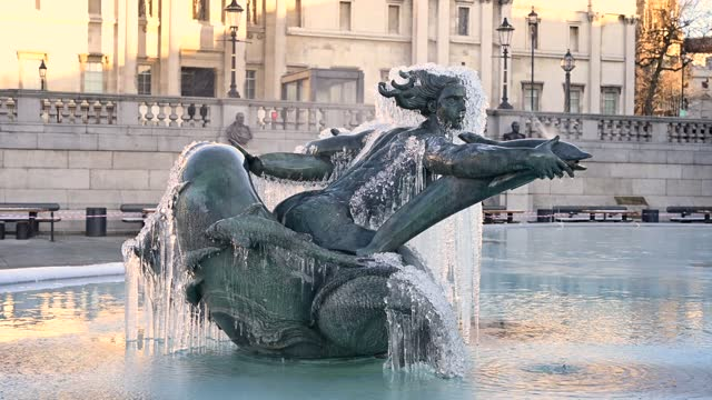 icicles hang from a statue in the fountains of trafalgar square on february 10 in london, england. heavy snow brings a week of freezing temperatures... - hanging stock videos & royalty-free footage