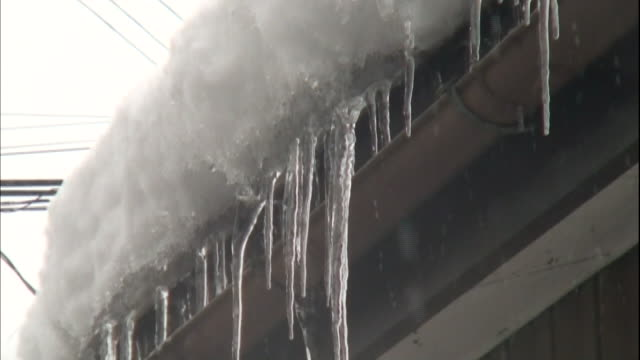 icicles hang from the eaves of a house in yamagata,japan. - eaves stock videos and b-roll footage