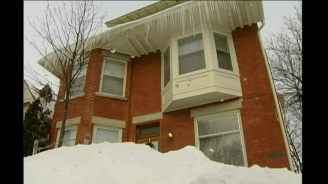 icicles hanging from roof of house woman along past waist high snow annie-marie decicco interview sot - waist stock videos & royalty-free footage