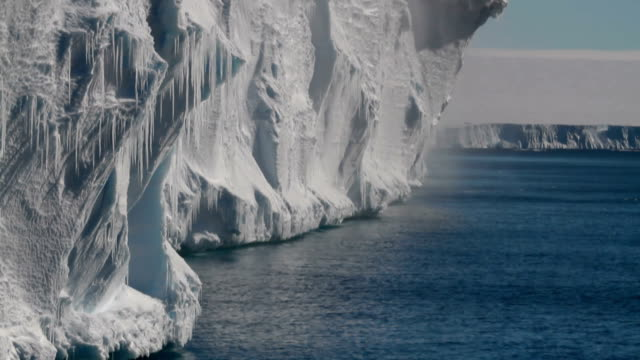 ws tilt icicles hanging off ice shelf with wind blowing off snow, antarctica - south pole stock videos and b-roll footage