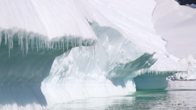 icicles melting, dripping, attached to icebergs in antarctica - icicle stock videos and b-roll footage