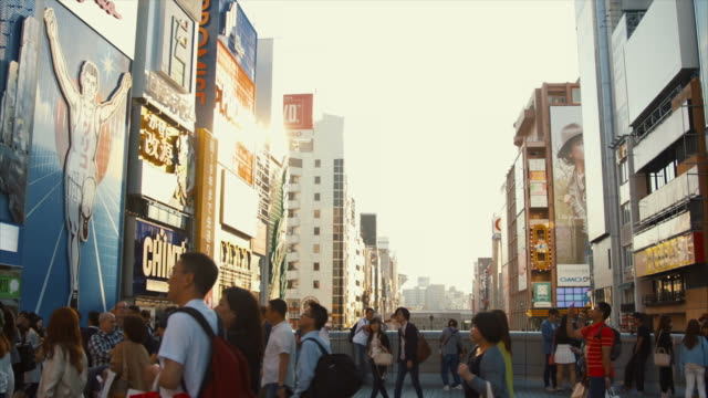 iconic dotonbori canal (slow motion) - electronic billboard stock videos and b-roll footage