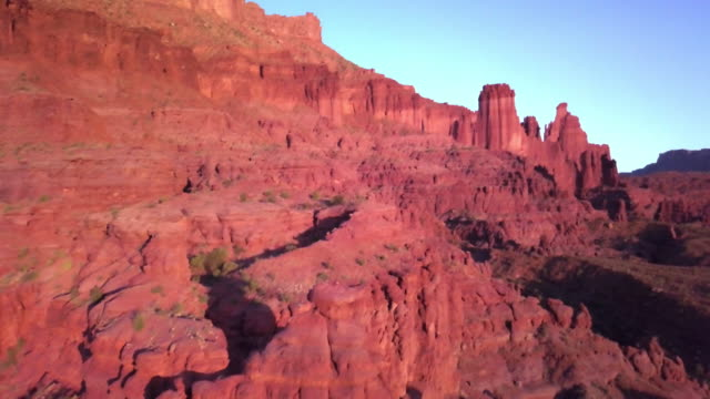 iconic fisher towers sandstone red rock formation near moab utah - red rocks stock videos & royalty-free footage