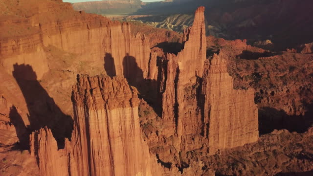 iconic fisher towers sandstone red rock formation near moab utah - badlands stock videos & royalty-free footage