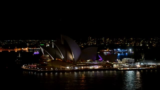 iconic landmarks and skylines were plunged into darkness on saturday as the earth hour switch off of lights around the world got under way to raise... - climate icon stock videos & royalty-free footage