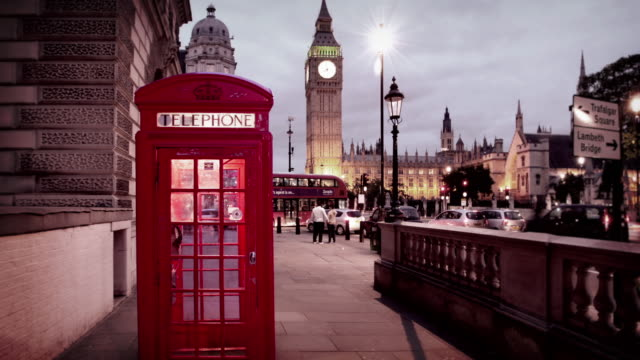 iconic london phone booths in front of house of parliament - london england stock videos & royalty-free footage