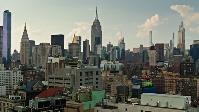 iconic manhattan buildings rising behind east village - ascending drone shot - empire state building stock videos & royalty-free footage