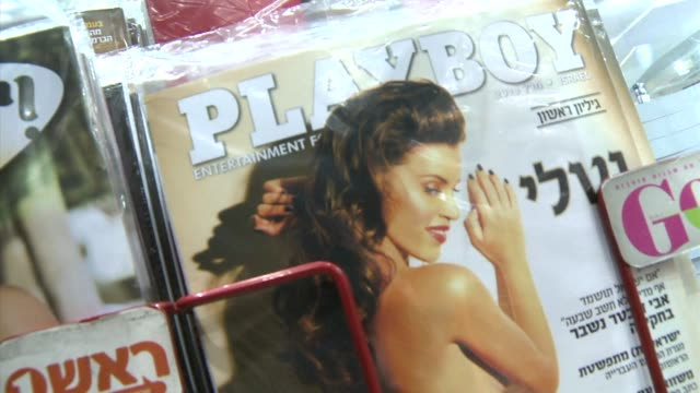 iconic mens magazine playboy hits the streets of israel in hebrew for the first time combining scantily clad israeli models with articles in the... - playboy magazine stock videos and b-roll footage