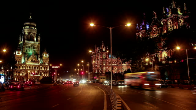 iconic shot of cst station and bombay municipal corporation building lit up - mumbai stock videos & royalty-free footage