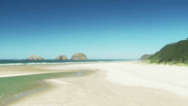 iconic three arch rocks in oregon from netarts bay - oregon coast stock videos & royalty-free footage