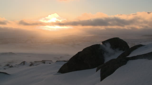 icy landscape at sunset with snow blowing, dartmoor, uk - dartmoor stock videos & royalty-free footage