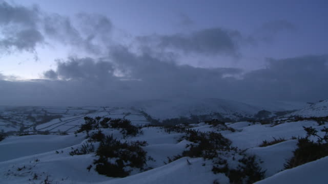 icy landscape with grey, looming cloud, dartmoor, uk - dartmoor stock videos & royalty-free footage