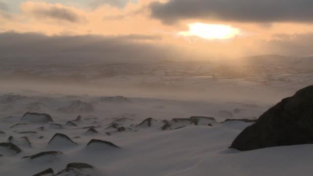 icy landscape with snow blowing across rocks, dartmoor, uk - dartmoor stock videos & royalty-free footage