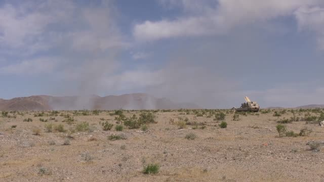idaho army national guard m1150 assault breacher vehicle live fires mine clearing line charges to sweep battlefields of improvised explosive devices... - infanterie stock-videos und b-roll-filmmaterial