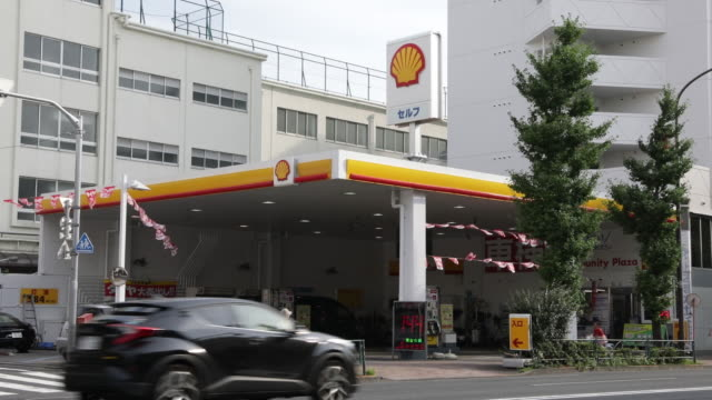 idemitsu kosan co and showa shell sekiyu kk gasoline stations stand in tokyo japan on tuesday july 17 2018 - personal land vehicle stock videos & royalty-free footage