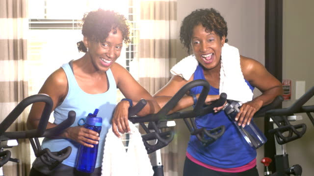 identical twin sisters at the gym, after exercising - identical twin stock videos & royalty-free footage