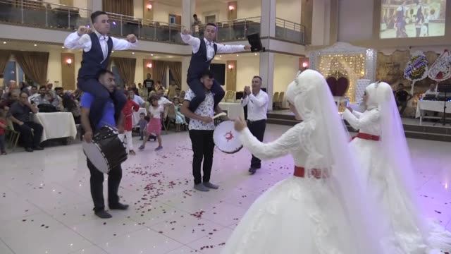 identical twin sisters ipek and dilek kucuk marry identical twin brothers mehmet ali and aziz ramazan gulec on august 21 2019 in turkey's southern... - sister stock videos & royalty-free footage