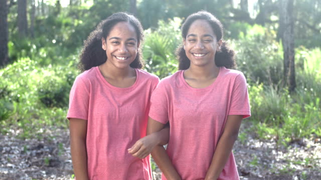 identical twin teenage african-american girls at park - teenagers only stock videos & royalty-free footage