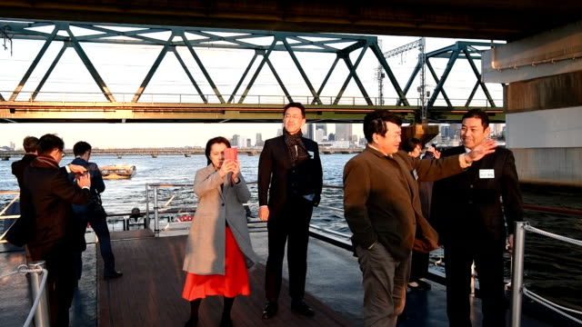 ideo footage taken on Dec 5 shows passengers taking in the sights of Osaka from a boat plying the city's waterways during an evening cruise arranged...