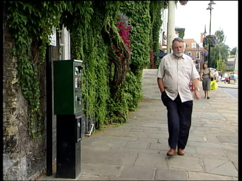 London Terry Waite towards down street Terry Waite interviewed SOT Many of my friends and colleagues suffered at his hands