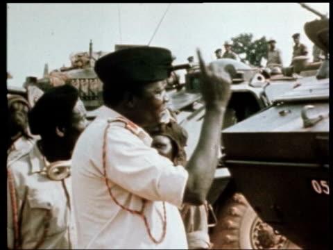 Idi Amin dies ITN Amin inspecting tanks