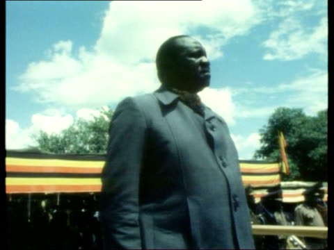 LIB Idi Amin standing on stage during ceremony CS Amin dancing with others Clean feed tape = D0624207 or D0624208 001128 to 001154 FX Programme as...