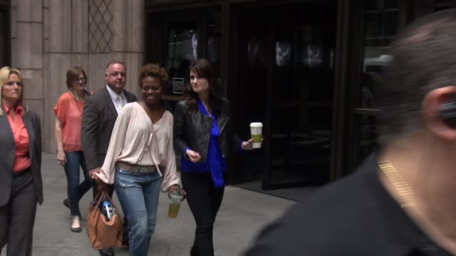 Idina Menzel walking outside of Sony with other cast members of their Broadway play 'If/Then' after doing a CD signing in Celebrity Sightings in New...