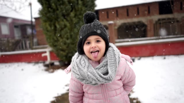 idlyllic scene of a four year old girl enjoying snow fall - cap hat stock videos & royalty-free footage