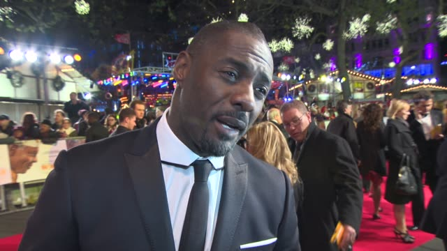 stockvideo's en b-roll-footage met idris elba on the royal family attending the premiere and his music at 'royal film performance 2013: 'mandela: long walk to freedom' on december 5,... - première