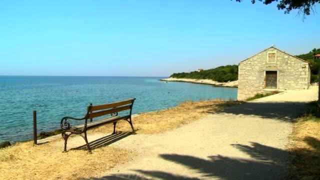 hd: idyllic beach scene in mediterranean sea - stone house stock videos & royalty-free footage