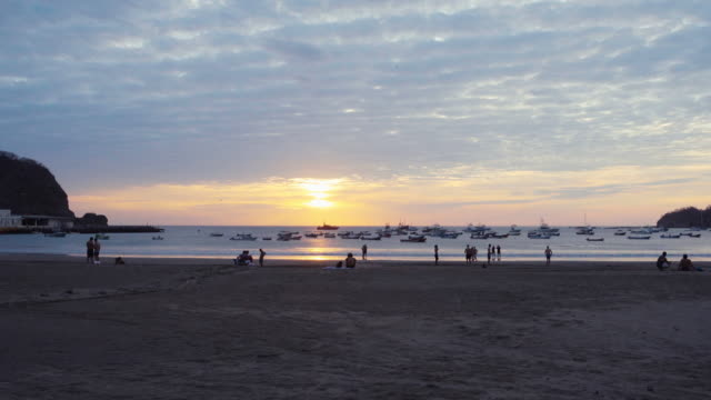 idyllic beach sunset with beautiful sky. san juan del sur. young people in silhouette playing football soccer and having holidays vacacions in nicaragua central america. - nicaragua stock videos and b-roll footage