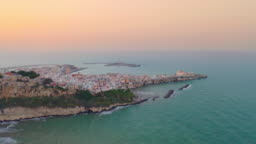 WS AERIAL VIEW Idyllic coastal town and sea at sunset, Vieste, Italy