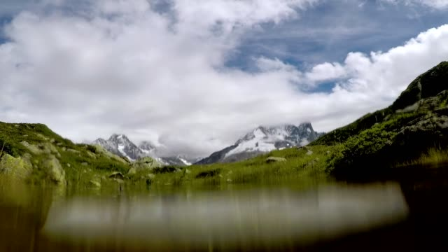 idyllic mountain landscape and underwater in mountain pond or lake - auvergne rhône alpes stock videos & royalty-free footage