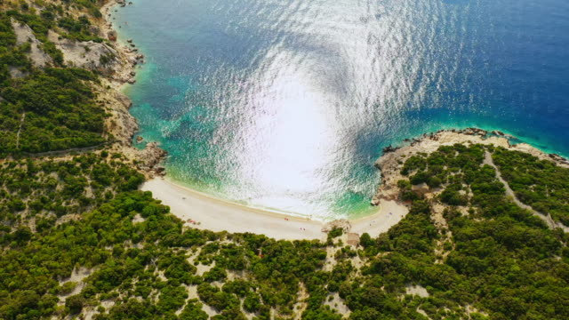 aerial idyllic remote beach lubenice - tourism stock videos & royalty-free footage