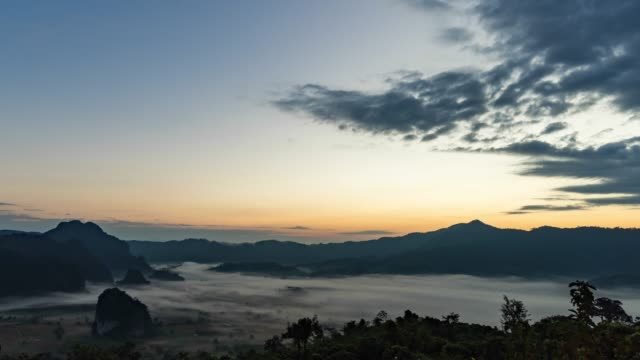 idyllic scene of fog roll across colorful mountains at sunrise, time lapse video - pinaceae stock videos & royalty-free footage