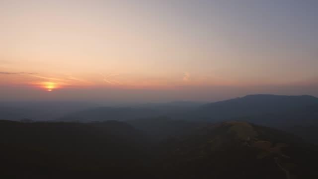 idyllic sunset on the horizon over the mountains - wonderlust stock videos & royalty-free footage