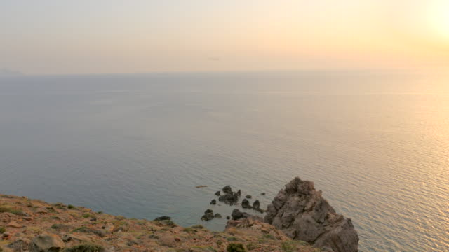 idyllic sunset & view from cliff - santorini stock videos and b-roll footage