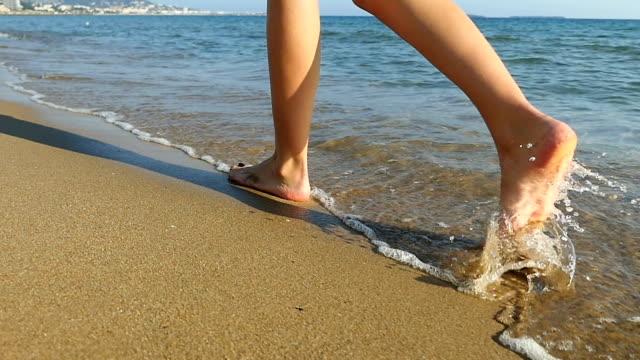 idyllic walking on beach - leg stock videos and b-roll footage