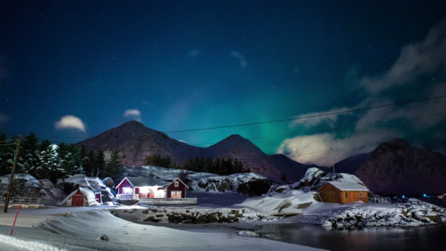 time lapse: idyllic winter landscape northern lights - norway stock videos & royalty-free footage