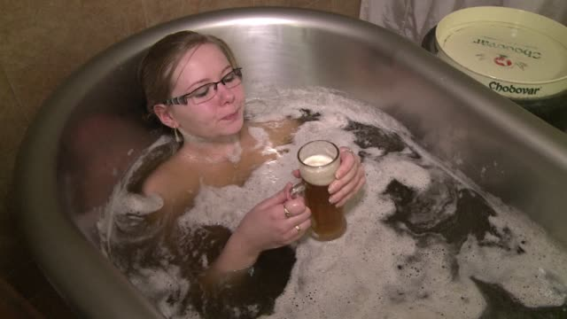if a pint of czech beer sounds good just imagine a tub full. clean : beer baths a hit at czech spa on january 23, 2013 in prague, czech republic - bohemia czech republic stock videos & royalty-free footage