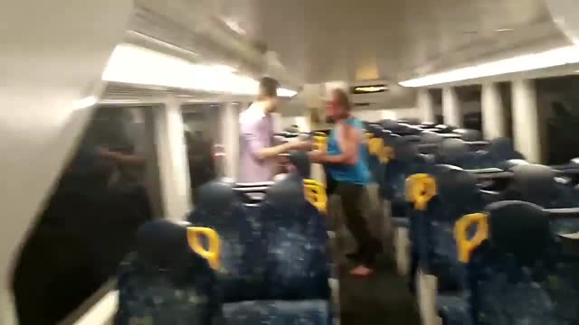 if only all wars ended like this - a fight aboard a sydney train on january 31 ended bizarrely in a hug. this video shows an older man approaching a... - https stock-videos und b-roll-filmmaterial