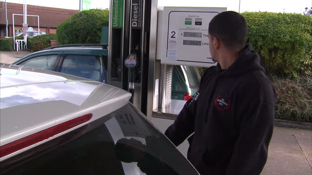if you are filling up this morning you could save a bit with a new price war driving down petrol prices at the big supermarkets asda tesco sainsburys... - price stock videos and b-roll footage