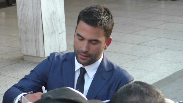 ignacio serricchio signs for fans outside the lost in space season 1 premiere at the cinerama dome in hollywood in celebrity sightings in los angeles - cinerama dome hollywood stock videos & royalty-free footage