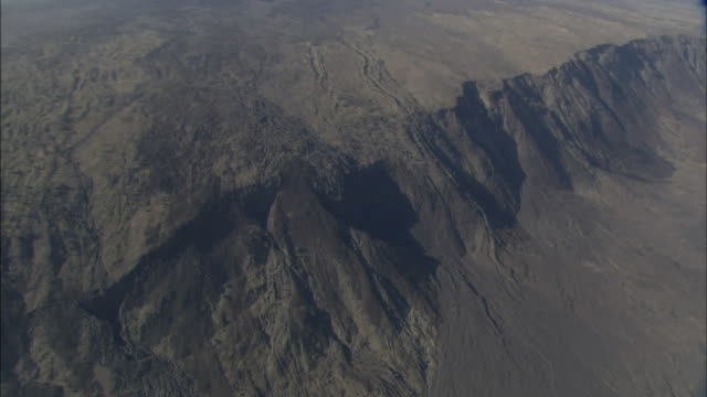 igneous rock forms a vast mountain ridge. - igneous stock videos & royalty-free footage