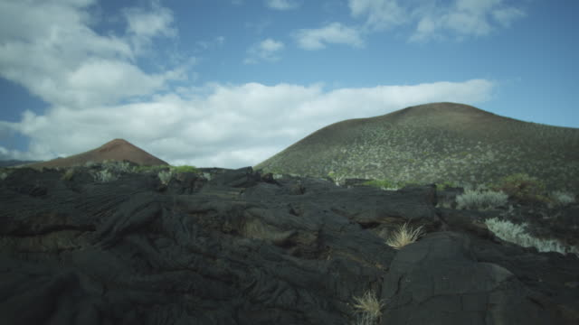 igneous rock, hills, sky, clouds, el hierro, canary islands, november 2011 - igneous stock videos & royalty-free footage