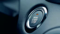 Ignition of car engine by pushing a button