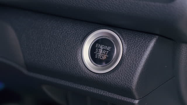 ignition of car engine by pushing a button . - ignition stock videos & royalty-free footage